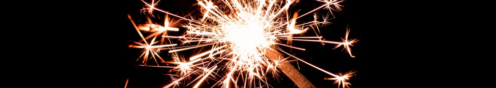 two sparklers light up the darkness